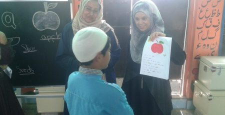 Trustee Seema Farouq Sheikh looks pleased during a conversation with a student.